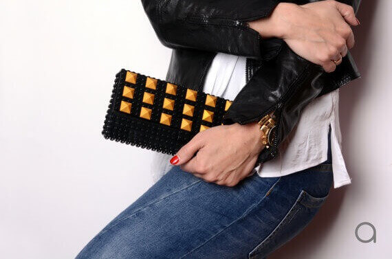Black clutch with gold studs